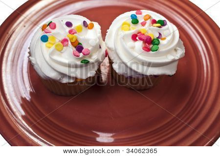 Two Cupcakes On Turquoise Plate