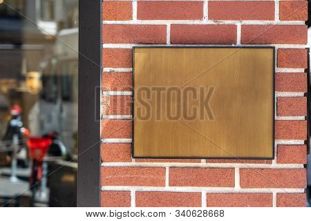 Wooden Plaque On A Brick Wall. Background