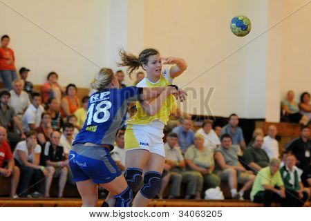 SIOFOK, HUNGARY - AUGUST 24: Unidentified players in action at a Siofok Cup handball game Feherep yellow (HUN) vs. Sparwagen blue (SWE) August 24, 2008 in Siofok, Hungary.