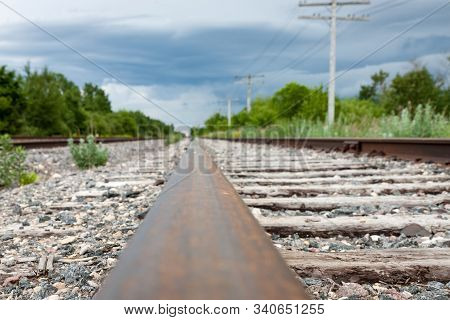 Ground Level View Of Rail And Weathered Railway Ties