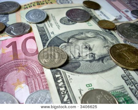 Coins And Dollar Banknotes