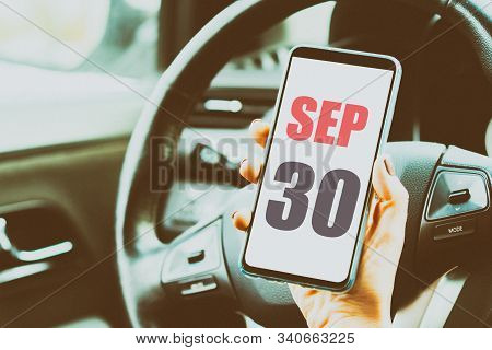 September 30th. Day 30 Of Month, Calendar Date. Month And Day Placed On A Smartphone Screen In Woman