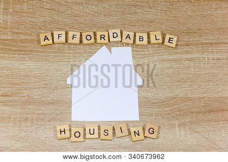 The Words Affordable Housing Wth A Paper House Shape