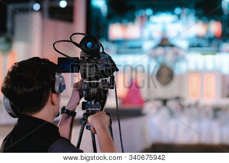 [camcorder While Filming] Video Camera Operator Working With His Equipment, Cameraman Recording Male