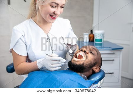 Young African-american Man Visiting Dentists Office For Prevention And Treatment Of The Oral Cavity.
