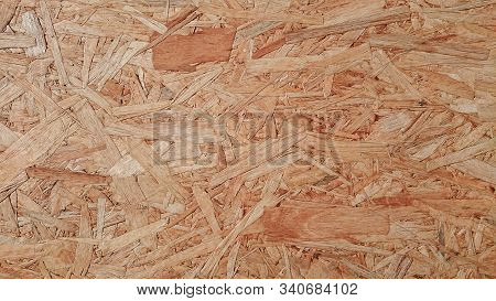Osb Boards Are Made Of Brown Wood Chips Sanded Into A Wooden Background. Top View Of Osb Wood Veneer