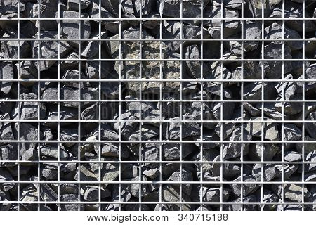 Texture Of Gabion Fence, Made Of Durable Mesh And Large Stones. European Gabion Fence