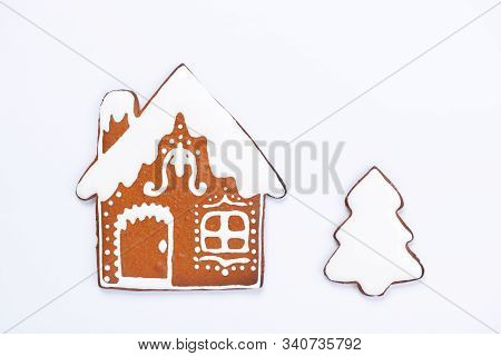 The Hand-made Eatable Gingerbread House And New Year Tree On White Background