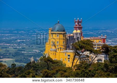 Sintra, Portugal - May, 2018: The Pena Palace Seen From The Gardens Of Pena Park At The Municipality