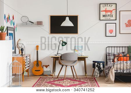 Stylish Desk And Chair In Workspace In Vintage Genderless Kid Room