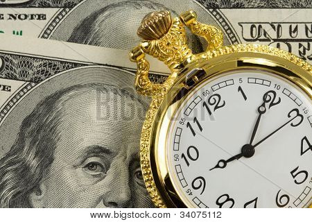gold watch on dollar money banknotes