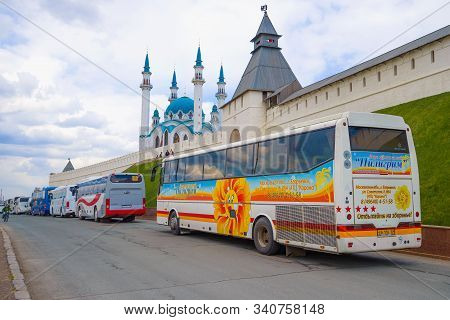 Kazan, Russia - April 30, 2016: Tourist Buses Near The Walls Of The Kazan Kremlin On An April Cloudy
