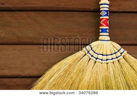 Broom On Wooden Wall