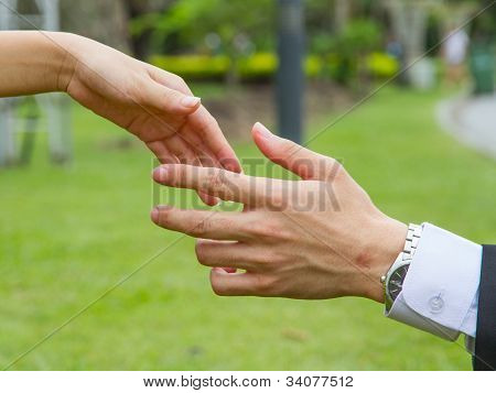 Hands Of Woman And Men