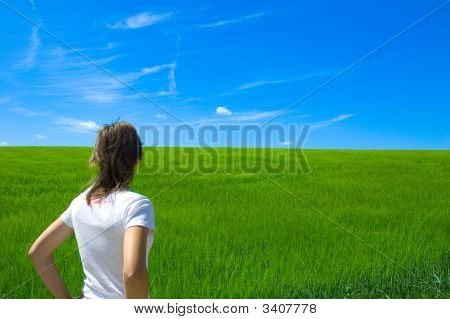 Girl Looking At Green Field