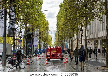 Paris, France, 09/10/2019: Street On The Champs Elysees. Roadworks On A Cloudy Rainy Day.