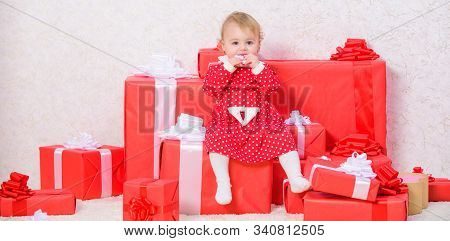Little Baby Girl Play Near Pile Of Gift Boxes. Celebrate First Christmas. Baby First Christmas Once