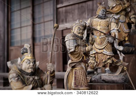 Fierce Looking Fudo Statues At The Entrance Of A Daishoin Shrine, Miyashima, Japan