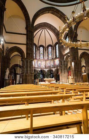 Priest And Altar Boy Prepare For Church Service In The Saint-pierre-le-jeune Church In Strasbourg