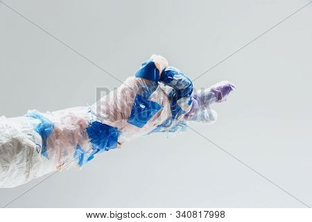 Big Plastic Hand Made Of Garbage Isolated On White Studio Background. The Result Of Polymers Overusi