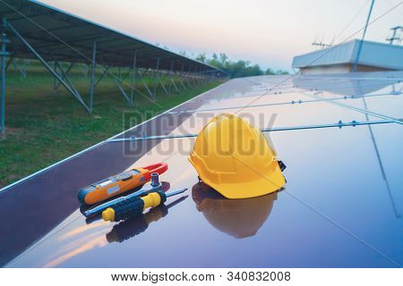 Construction Equipment Tools With Solar Panels Or Solar Cells On The Roof In Farm. Power Plant With