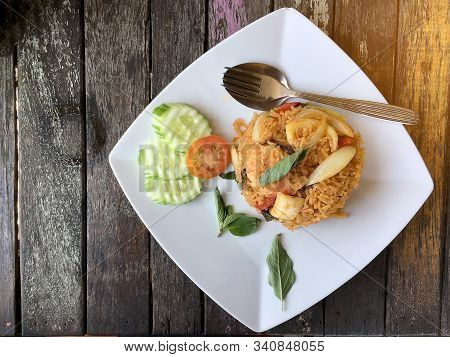 Fried Rice With Shrimp And Vegetable In White Plate On The On Beautiful Wooden Table Background From