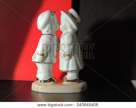 Porcelain Figurine On Abstract Backgrounds.kissing Porcelain.porcelain Figurine On Abstract Backgrou