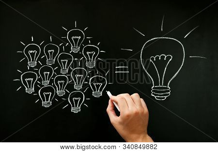 Hand Drawing With Chalk On Blackboard Light Bulbs Concept Illustrating How A Business Team Is Workin