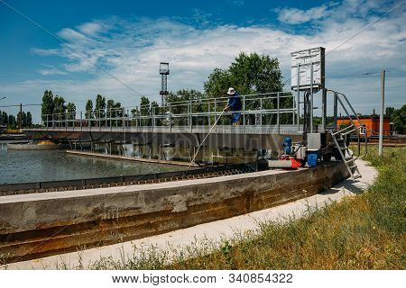 Modern Urban Sewage Treatment Plant. Dirty Waste Water Flowing In Sedimentation Tank