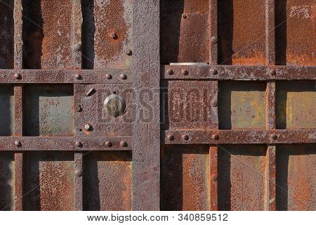 Closeup Of Old Rusty Metal Lock And Keyhole On A Old Iron Door As A Beautiful Vintage Background. Fr