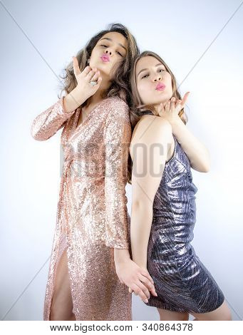 Two Attractive And Funny Girlfriends Wearing In Shiny Dresses, Fellows Fellowship Send Air Kiss Attr