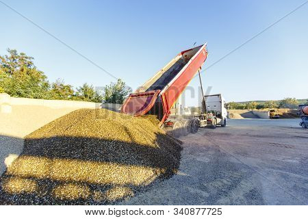 Dump Truck Unloads Crushed Stone From The Body At The Concrete Plant. The Dump Truck Lifts The Body