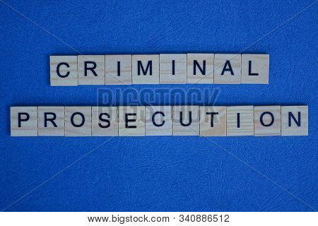 Phrase Criminal Prosecution Made From Gray Wooden Letters Lies On A Blue Background