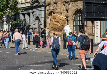 LONDON - SEPTEMBER 20, 2019: Climate Change protester holding a homemade protest sign at an Extinction Rebellion march