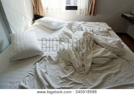 Bed And Pillows, White Blankets With Wrinkled  In The Bedroom