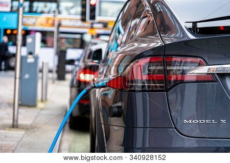 Glasgow, Scotland - July 31, 2019: The Tesla Model X Suv Electric Car Charged At The Public Charging