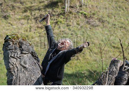 Happy Senior Artist Celebrating Great Progress Of His Work Of Art Raising His Hands In The Air Holdi