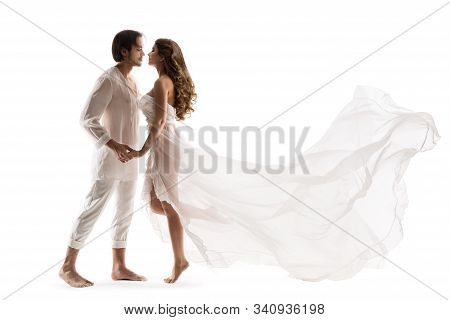 Couple In Love, Man Kissing Beautiful Woman In Sexy Dress, Over White Background