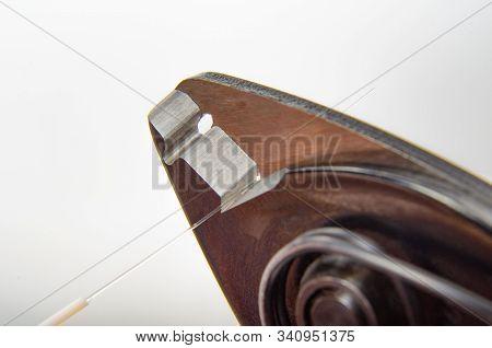 Optical Fiber Stripper And Fiber Optic Filament Isolated Background Close-up