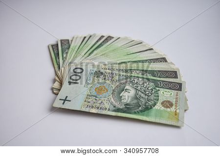 Polish Zloty Currency, Poland Money On The White Background, One Hundred And Two Hundred Polish Cash