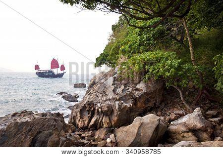 Traditional Chinese Junk Sailing Off Hong Kong Island