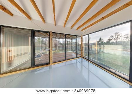 White Empty Apartment Interior With Panoramic Windows And Wooden Rafter Ceiling In Vacation Homestea