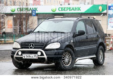 Novyy Urengoy, Russia - June 1, 2016: Black Motor Car Mercedes-benz M-class (w163) In The City Stree