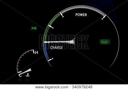 The Dashboard Of The Car Is Glowing White With Arrows At Night With A Speedometer, Charge Battery Le