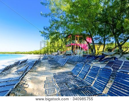 Colorful Tropical Cabanas Or Shelters On The Beach Of Half Moon Cay In The Bahamas With Turquoise Se