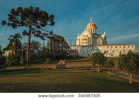 Cathedral And Building At The Sanctuary Of Our Lady Of Caravaggio On Sunset, In A Wooded Park Near B