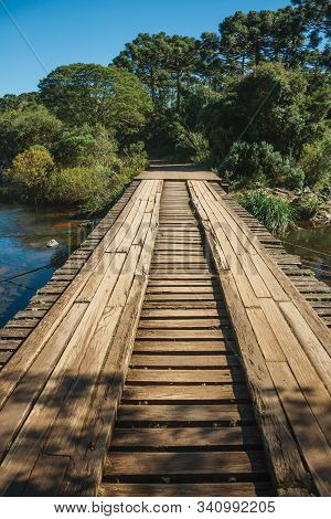 Wooden Bridge Over Creek And Trail Through Forest At The Aparados Da Serra National Park Near Cambar
