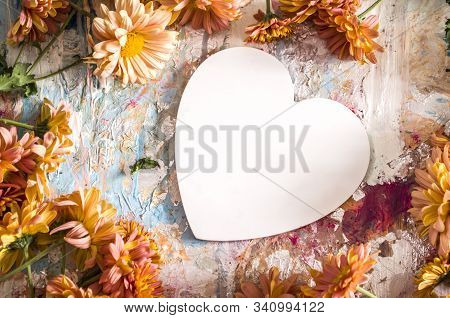 White Heart Surrounded By Orange Chrysanthemums.valentine Day Concept With Place For Text.