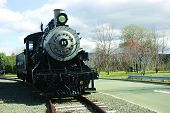 Old Steam Engine on sunny day on the tracks poster
