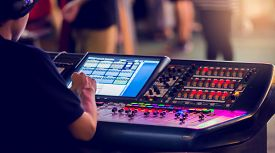 Technicians Are Controlling The Sound System And Lighting System On The Concert Stage.